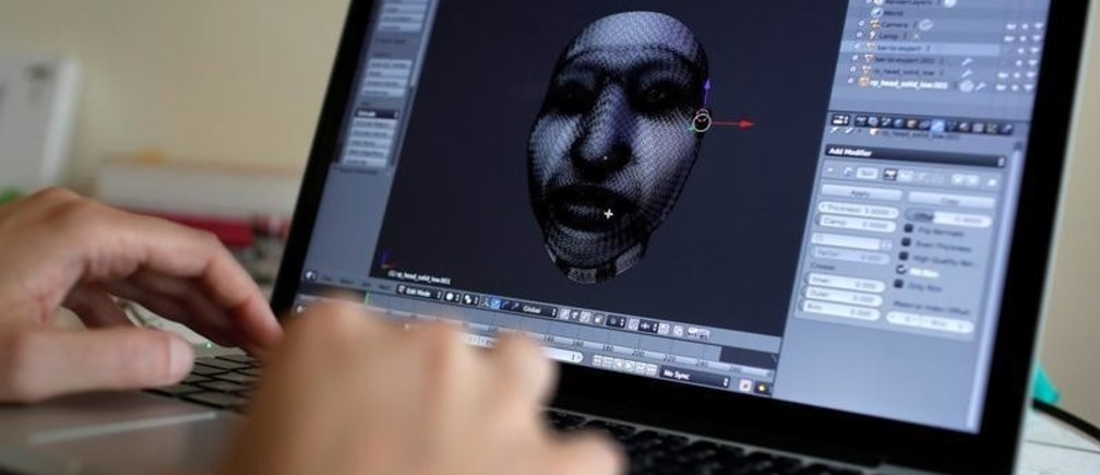 """Artist Heather Dewey-Hagborg works in her studio where she created computer models for 3-D printed masks created from DNA extracted from cheek swabs and hair clippings she received from formerly imprisoned U.S. Army Private Chelsea Manning while she was in jail, ahead of the August 2, 2017 opening of  """"A Becoming Resemblance"""", an exhibition at the Fridman gallery in New York City, July 7, 2017."""