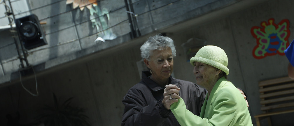 Two women, patients with Alzheimer's and dementia, dance inside the Alzheimer foundation in Mexico City April 19, 2012. Alzheimer's is a progressive, degenerative disease that robs people of memory, reasoning and the ability to communicate. About 24 million people worldwide have the disease according to the World Health Organization. In Mexico, 600,000 Mexicans out of 9 million adults over the age 60 suffer from Alzheimer's, according to the Institute of Geriatrics (INGER). Picture taken April 19, 2012. REUTERS/Edgard Garrido