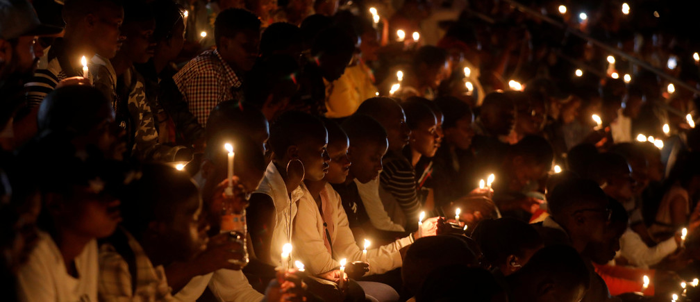 grenocide trauma mental health - Participants hold candles while holding a night vigil during a commemoration ceremony marking the 25th anniversary of the Rwandan genocide, at the Amahoro stadium in Kigali, Rwanda April 7, 2019. REUTERS/Baz Ratner - RC16AEFF9C60