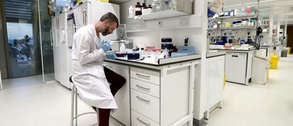 Dr Chris Millington, an investigator scientist, works in the lab at MRC Laboratory of Molecular Biology in Cambridge, Britain January 2, 2018. Picture taken January 2, 2018. REUTERS/Chris Radburn