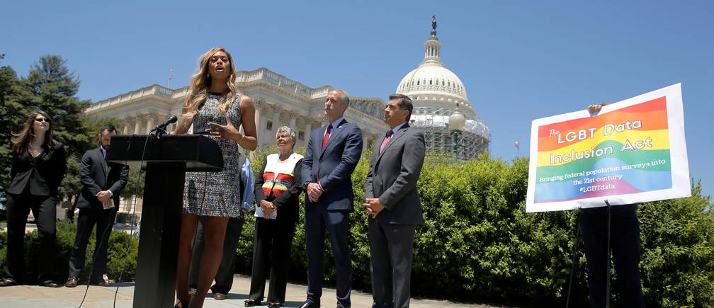 Actress Laverne Cox (at lectern) speaks at a news conference with Democratic lawmakers in favor of the LGBT Date Inclusion Act at the U.S. Capitol in Washington, U.S. June 9, 2016. REUTERS/Jonathan Ernst - RTSGTPK