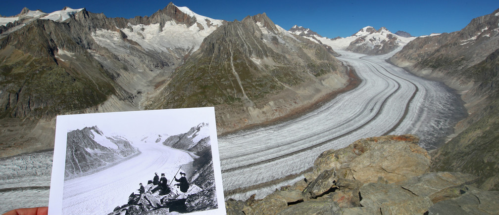 A handout picture of the Aletsch Glacier in Fieschertal, Switzerland taken between 1860 and 1890 and released by Library of Congress, is displayed at the same location on September 4, 2019. Picture taken September 4, 2019. REUTERS/Denis Balibouse and Library of Congress/Handout via REUTERS THIS IMAGE HAS BEEN SUPPLIED BY A THIRD PARTY.     TPX IMAGES OF THE DAY - RC29ID9HB2R9