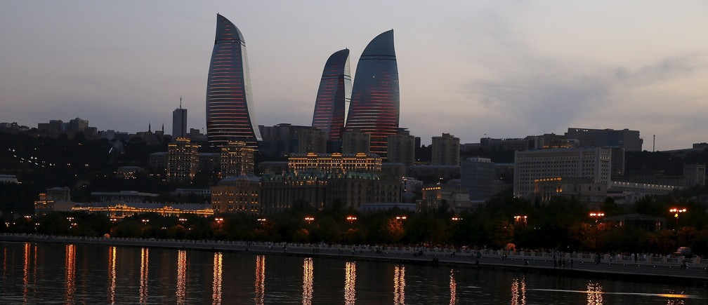 The skyline, with the Flame Towers, of Baku is seen at sunset, Azerbaijan June 18, 2015.