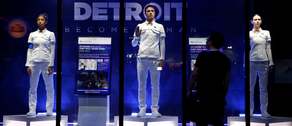 """A man looks at models of android robots, game characters from """"Detroit: Become Human"""" at Tokyo Game Show 2017 in Chiba, east of Tokyo, Japan, September 21, 2017. REUTERS/Kim Kyung-Hoon - RC198D7E9EA0"""