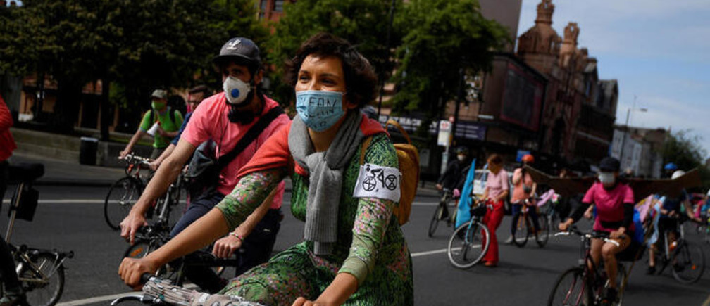 Members of Extinction Rebellion take part in a socially distanced bicycle ride to campaign for more cycling and cycle lanes and fewer vehicles on the roads, following the outbreak of the coronavirus disease (COVID-19), London, Britain, May 17, 2020. REUTERS/Toby Melville