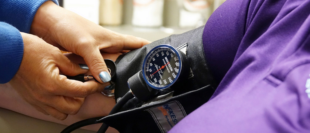 A nurse takes someones blood pressure inside the East Arkansas Family Health Center in Lepanto, Arkansas, U.S., May 2, 2018. Picture taken May 2, 2018.    To match Special Report USA-HEALTHCARE/ARKANSAS     REUTERS/Karen Pulfer Focht - RC1C8E69F7C0