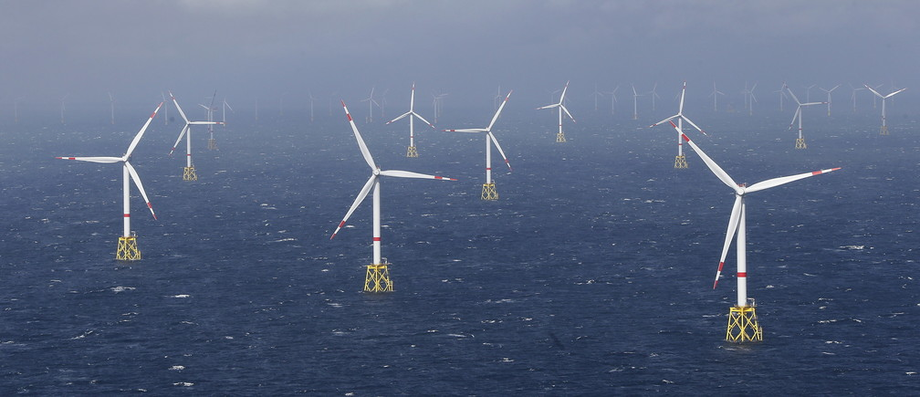 Power-generating windmill turbines are pictured at the 'Amrum Bank West' offshore windpark in the northern sea near the island of Amrum, Germany September 4, 2015. REUTERS/Morris Mac Matzen - GF10000193712