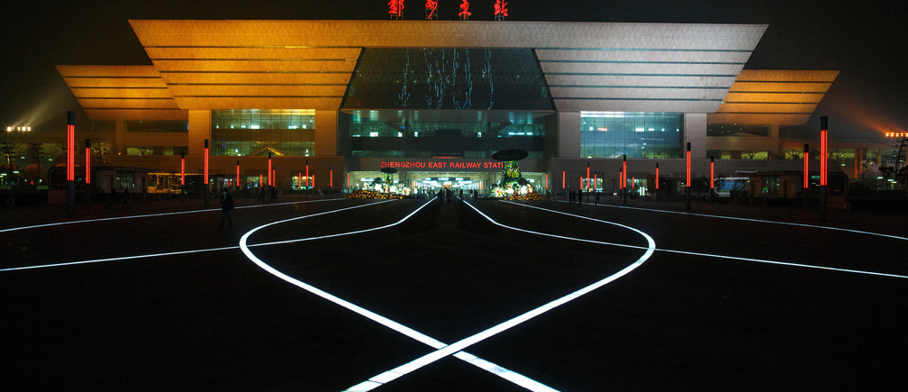 LED lights in the pavement illuminate the square in front of a high speed railway station in the new business district of Zhengzhou, Henan province China February 19, 2019. REUTERS/Thomas Peter