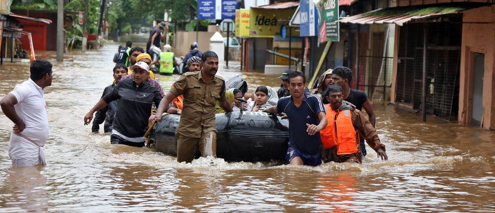 Rescuers evacuate people from a flooded area to a safer place in Aluva in the southern state of Kerala, India, August 18, 2018.