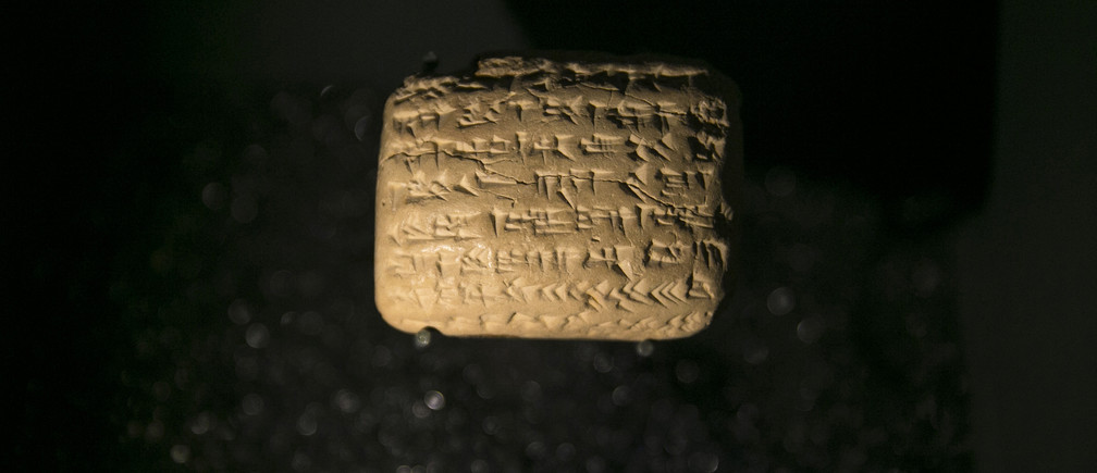 A cuneiform tablet is displayed during an exhibition at the Bible Lands Museum in Jerusalem, February 3, 2015. The exhibition of ancient clay tablets from modern-day Iraq is shedding light for the first time on the daily lives of Jews who were exiled to Babylon from Jerusalem some 2,500 years ago.The exhibition is based on more than 100 cuneiform tablets, each no bigger than an adult's palm, that detail transactions and contracts between Judeans driven out of or convinced to move from Jerusalem by King Nebuchadnezzar in 600 BC.REUTERS/Baz Ratner (JERUSALEM - Tags: SOCIETY TPX IMAGES OF THE DAY) - GM1EB231MKN01