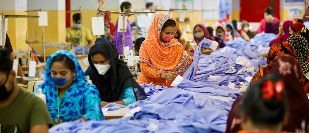 Women work in a garment factory, as factories reopened after the government has eased the restrictions amid concerns over coronavirus disease (COVID-19) outbreak in Dhaka, Bangladesh, May 3, 2020. REUTERS/Mohammad Ponir Hossain - RC2WGG9FHRT8