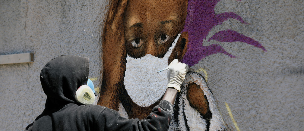 Serigne Boye aka Zeus, a graffiti artist from RBS crew works on his mural to encourage people to protect themselves amid the outbreak of the coronavirus disease (COVID-19), in Dakar, Senegal March 25, 2020. Picture taken March 25, 2020. REUTERS/Zohra Bensemra - RC2BSF9EKZX1