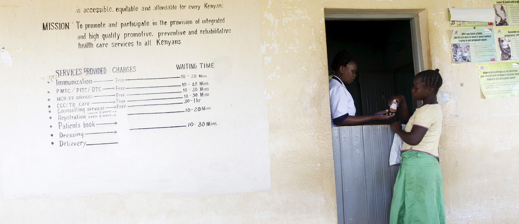 A patient collects medicine at the Kogelo Dispensary in the U.S. President Barack Obama's ancestral village of Nyang'oma Kogelo, west of Kenya's capital Nairobi, July 16, 2015.