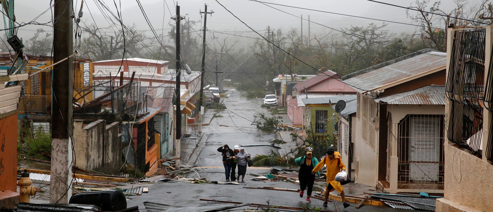 Rescue workers help people after the area was hit by Hurricane Maria in Guayama, Puerto Rico September 20, 2017.