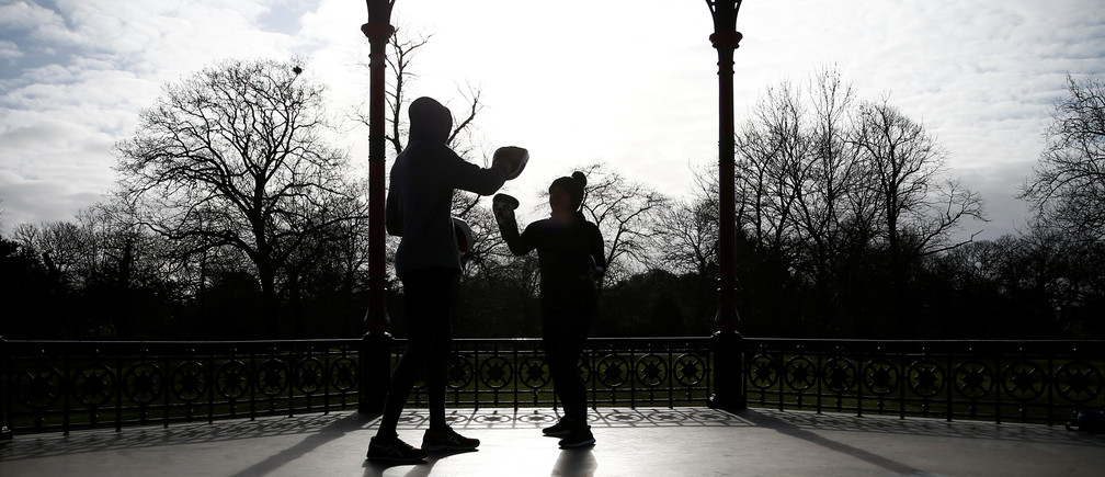 People are seen exercising in Greenwich Park, as the spread of the coronavirus disease (COVID-19) continues, London, Britain, March 29, 2020. REUTERS/Henry Nicholls - RC2LTF9B76QP