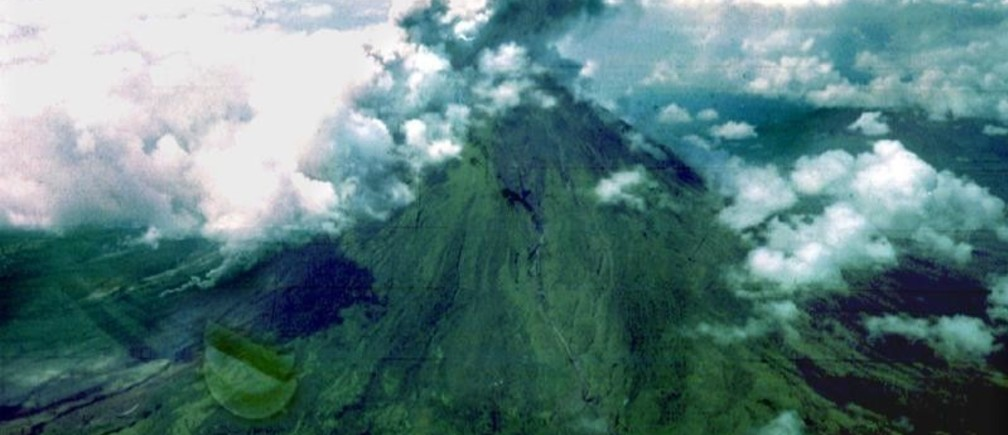 Smoke billows from the crater of Mayon volcano in the Philippines as it belched steam, ash and rocks in a series of moderate eruptions, February 12 - PBEAHUNIYDP