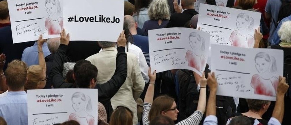 People hold up placards during a special service for murdered Labour Party MP Jo Cox, at Trafalgar Square in London, Britain June 22, 2016.