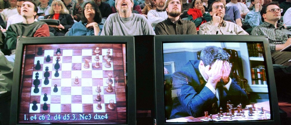 World chess champion Garry Kasparov rests his head in his hands as he is seen on a monitor during game six of the chess match against IBM supercomputer Deep Blue , May 11, 1997. The supercomputer made chess history Sunday when it defeated Kasparov for an overall victory in their six game re-match, the first time a computer has triumphed over a reigning world champion in a classical match. Kasparov resigned after 19 moves.  REUTERS/Peter Morgan - PBEAHUMLZBW