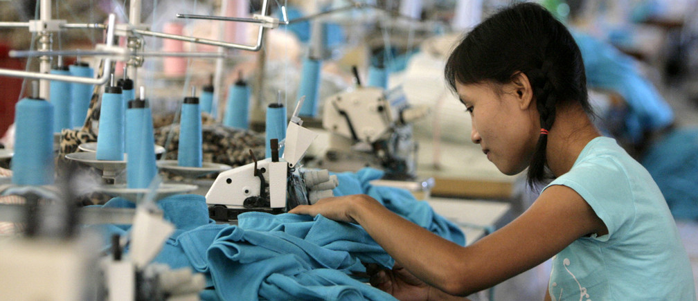 A Myanmar migrant works in a Taiwanese-owned garment factory in the northwestern Thai town of Mae Sot May