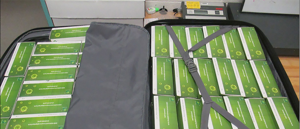 A suitcase containing 1,000 counterfeit COVID-19 Rapid Tests is seen after they were seized from a Mexican man by U.S. Customs and Border Protection (CBP) officers at the Santa Teresa border crossing in El Paso, Texas, U.S. May 16, 2020. Picture taken May 16, 2020.