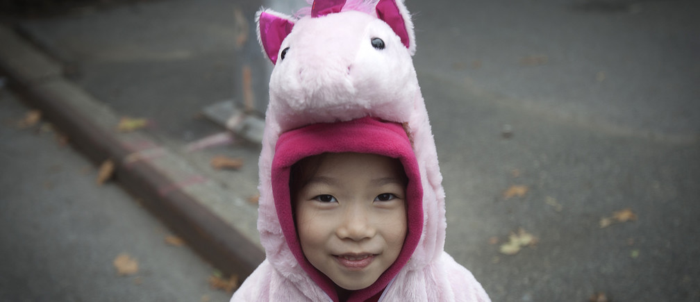 A child  in a unicorn costume takes part in the 24th Annual Greenwich Village Children's Halloween Parade in the Manhattan borough of New York October 31, 2014.     REUTERS/Carlo Allegri (UNITED STATES - Tags: SOCIETY) - GM1EAB10F7W01