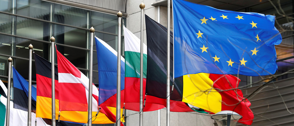 European and national flags fly outside the European Parliament while European Commission President Jean-Claude Juncker presents a white paper on options for shoring up unity once Britain launches its withdrawal process, in Brussels, Belgium, March 1, 2017. REUTERS/Yves Herman - RTS10Z4B