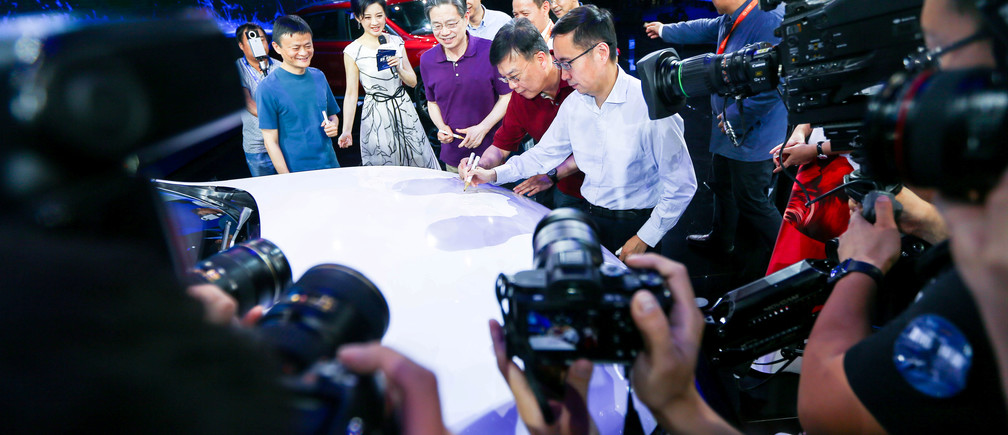 Jack Ma (L), Alibaba's founder and chairman, and other company leaders attend the launch event of a internet-connected car in Hangzhou, Zhejiang province, July 6, 2016. China Daily/via REUTERS ATTENTION EDITORS - THIS PICTURE WAS PROVIDED BY A THIRD PARTY. EDITORIAL USE ONLY. CHINA OUT. NO COMMERCIAL OR EDITORIAL SALES IN CHINA. - RTX2JYXW