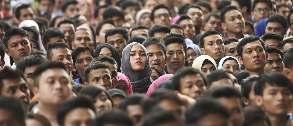 Ten of thousands job seekers wait outside Gelora Bung Karno stadium to enter for a job fair in Jakarta, Indonesia August 11, 2015 in this photo taken by Antara Foto.
