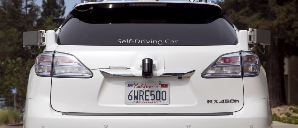 File photograph shows the rear of a Lexus SUV equipped with Google self-driving sensors during a media preview of Google's prototype autonomous vehicles in Mountain View, California September 29, 2015. Britain said on March 12, 2016  it will begin trialling driverless cars on motorways for the first time in 2017, as it moves towards its goal of allowing autonomous cars to take to the streets by 2020. Finance minister George Osborne will announce plans on Wednesday to test vehicles on motorways and say the government will bring forward proposals to remove regulatory barriers to the technology, the Treasury said. Alphabet Inc GOOGL.O unit Google wants to eventually be able to deploy fully autonomous vehicles without human controls, and major automakers are racing to develop vehicles that can drive themselves at least part of the time.  REUTERS/Elijah Nouvelage/Files - RTX28TLD