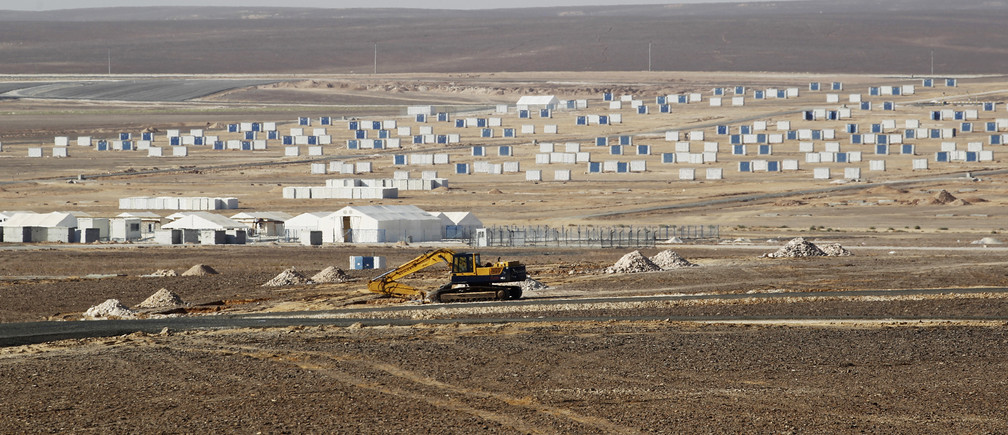 A general view of the Azraq Syrian Refugee Camp, the third of its kind, under construction near Al Azraq, 80km (50 miles) east of Amman, September 1, 2013. Azraq Refugee Camp is divided into 12 villages with a holding capacity of 5 to 15,000 people per village, in a total land area of 850 hectares, according to a report issued by United Nations High Commissioner for Refugees (UNHCR). REUTERS/Muhammad Hamed (JORDAN - Tags: POLITICS SOCIETY IMMIGRATION CONFLICT BUSINESS CONSTRUCTION) - RTX133ZN
