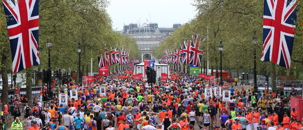 Athletics - Virgin Money London Marathon - London - 26/4/15 General view of runners after finishing the Virgin Money London Marathon Action Image