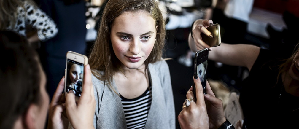 A model poses for pictures ahead of the fashion show by Danish fashion designer Nicholas Nybro during Copenhagen Fashion Week at the Copenhagen City Hall, August 7, 2015.