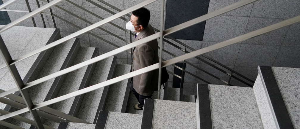 A professor of Pusan National University Park Hyun who used to be a coronavirus patient, walks up the stairs at Pusan National University in Busan, South Korea, March 30, 2020. REUTERS/Kim Hong-Ji - RC2TUF9GMDWS