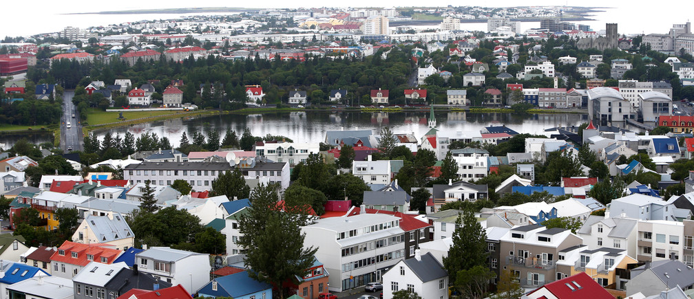 A general view shows the city of Reykjavik, seen from Hallgrimskirkja church, Iceland August 4, 2017. REUTERS/Michaela Rehle - RC16F92E2820