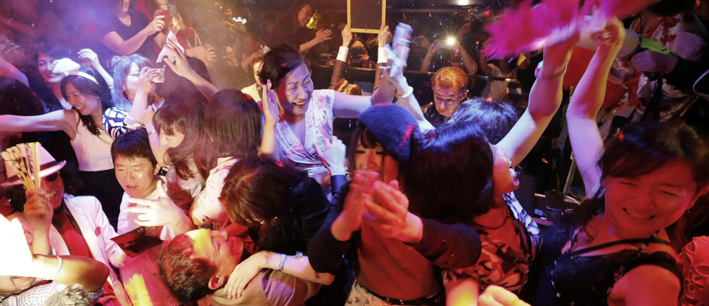 People celebrate the start of Japan's new Reiwa imperial era