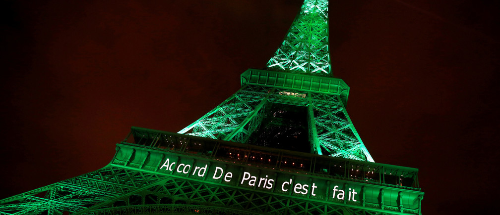 "The Eiffel tower is illuminated in green with the words ""Paris Agreement is Done"", to celebrate the Paris U.N. COP21 Climate Change agreement in Paris, France, November 4, 2016. REUTERS/Jacky Naegelen"
