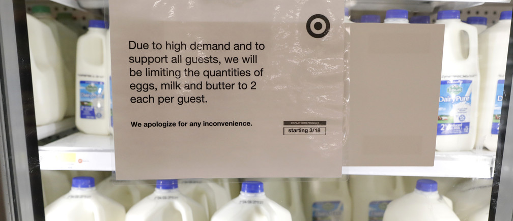 A sign is seen on the milk and dairy display case at a Target store in Manhattan during the outbreak of the coronavirus disease (COVID-19) in New York City, New York, U.S., April 1, 2020. REUTERS/Brendan Mcdermid - HP1EG411CSD1W