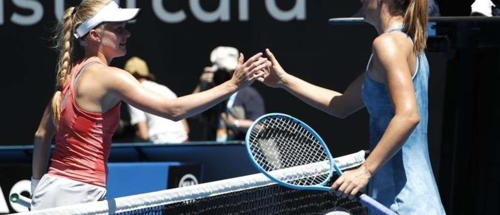 Tennis - Australian Open - First Round - Rod Laver Arena, Melbourne, Australia, January 14, 2019. Russia's Maria Sharapova reaches out to Britain's Harriet Dart for a handshake after Sharapova wins the match. REUTERS/Kim Kyung-Hoon - UP1EF1E04BJ7M