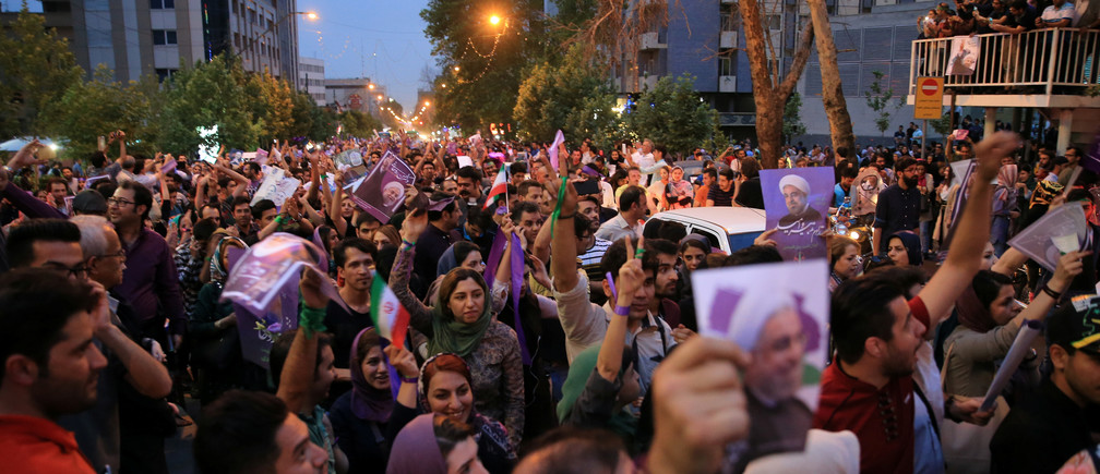 Supporters of Iranian president Hassan Rouhani gather as they celebrate his victory in the presidential election in Tehran, Iran, May 20, 2017. TIMA via REUTERS ATTENTION EDITORS - THIS IMAGE WAS PROVIDED BY A THIRD PARTY. FOR EDITORIAL USE ONLY. - RTX36R1Q