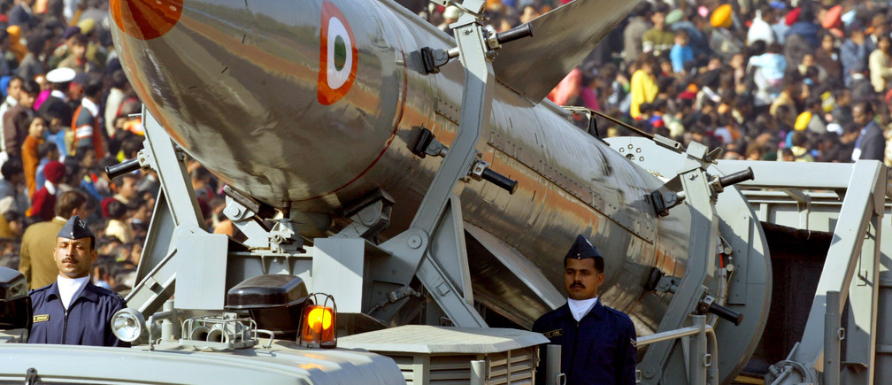 Indian soldiers stand beside India's surface-to-surface missile 'Prithvi' during full dress rehearsals for the Republic Day parade in New Delhi January 23, 2006. Prithvi, which means earth in Sanskrit, is a nuclear-capable missile. India's 57th Republic Day will be celebrated on January 26, 2006. REUTERS/Kamal Kishore - RP3DSFDBATAA