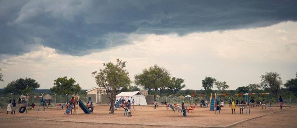 Children from South Sudan and Uganda playing together at Save the Children's center, Bidi Bidi settlement, northern Uganda