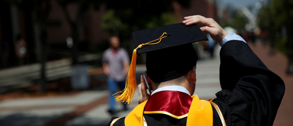 A graduate holds their mortarboard cap after a commencement ceremony at the University of Southern California (USC) in Los Angeles, California, U.S., May 12, 2017. REUTERS/Patrick T. Fallon - RTS16FCV