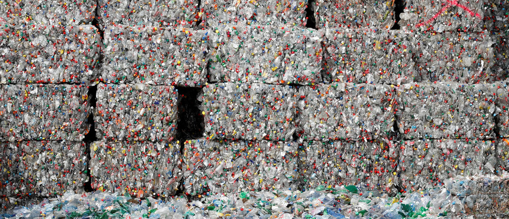 Bundles of pressed bottles made from PET (polyethylene terephthalate) plastic are stored at Poly Recycling AG company in Bilten, Switzerland April 3, 2019. REUTERS/Arnd Wiegmann - RC11F0072980