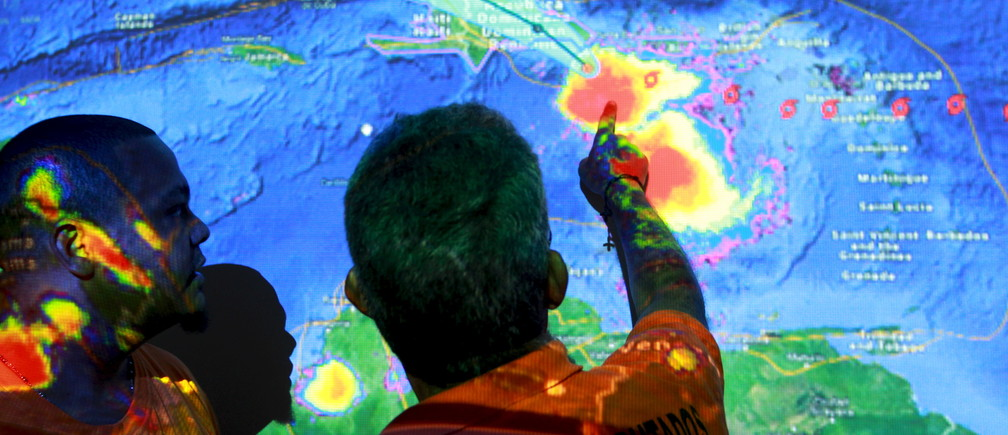 Members of the Emergency Operations Committee (COE) monitor the trayectory of Tropical Storm Erika via satellite in Santo Domingo, August 28, 2015. Tropical Storm Erika threatened Haiti and the Dominican Republic with heavy rain and strong winds on Friday as it swirled across the Caribbean and geared up for a run at South Florida, the U.S. National Hurricane Center said. Due to some likely weakening over mountainous areas, Erika was no longer forecast to make U.S. landfall as a hurricane. REUTERS/Ricardo Rojas    - GF10000185479