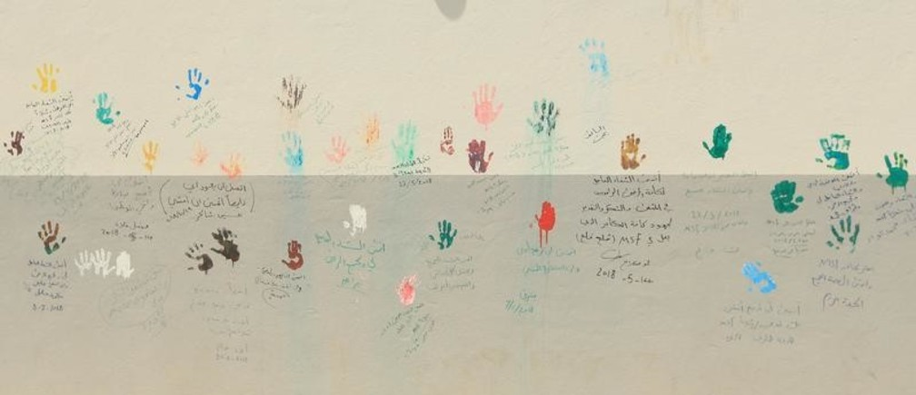 A mural is painted by hands and messages from wounded people, who had been recovered and discharged from the Medecins Sans Frontieres hospital in Mosul, Iraq July 10, 2018. Picture taken July 10, 2018. REUTERS/Ari jalal      TPX IMAGES OF THE DAY - RC11B3541CC0
