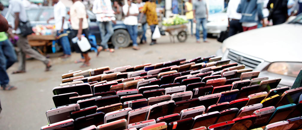 Smartphones are displayed for sale at the 'Computer Village' in Ikeja district in Nigeria's commercial capital Lagos, Nigeria May 31, 2017. REUTERS/Akintunde Akinleye - RC18CAE7A480