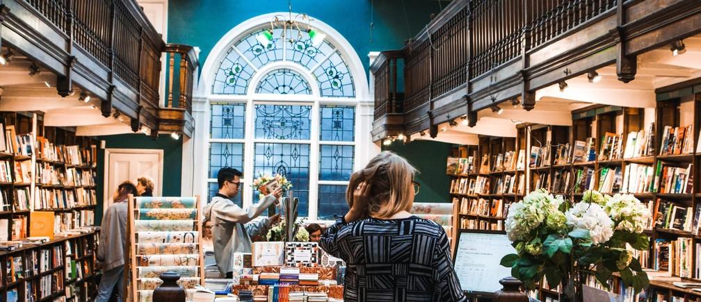 People browsing in a bookshop.