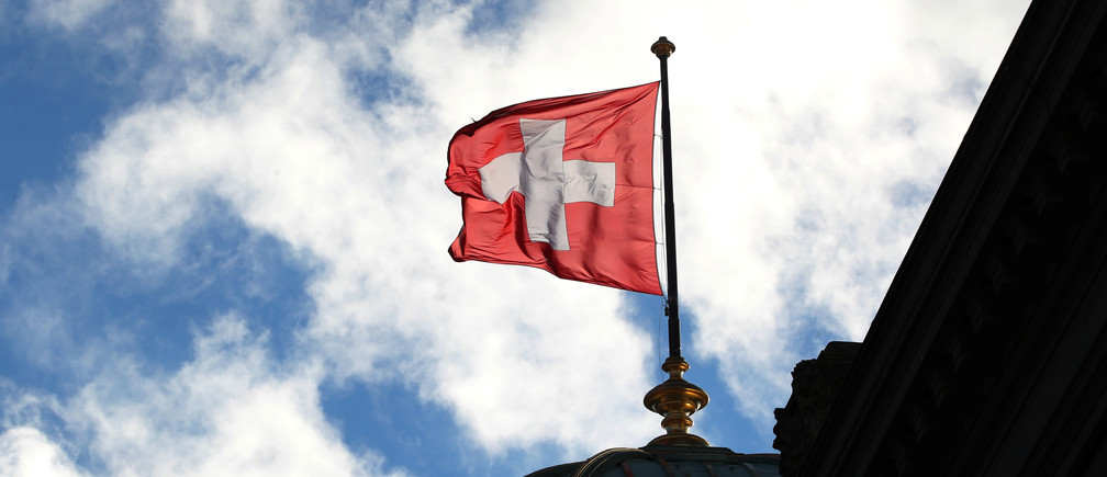 A Swiss flag is pictured on the Federal Palace (Bundeshaus) in Bern, Switzerland December 7, 2018. Picture taken December 7, 2018.  REUTERS/Denis Balibouse - RC1F1BC7CB70