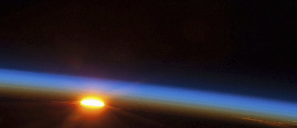 The sun is about to come up over the South Pacific Ocean in this colorful scene photographed by one of the Expedition 35 crew members aboard the Earth-orbiting International Space Station between 4 and 5 a.m. local time on May 5, 2013 and released on May 9, 2013. The space station was at a point above Earth located at 27.4 degrees south latitude and 110.1 degrees west longitude, a few hundred miles east of Easter Island.  NASA/Handout via Reuters