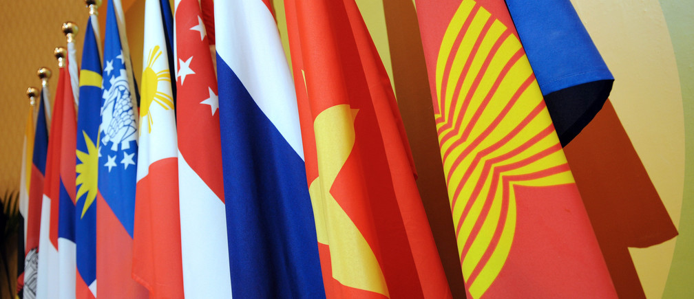 The Association of Southeast Asian Nations (ASEAN) flag (R) leads the flags of the 10-member countries during the ASEAN Regional Forum meeting.